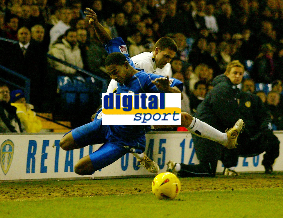 Fotball<br /> England 2004/2005<br /> Foto: BPI/Digitalsport<br /> NORWAY ONLY<br /> <br /> Leeds United v Millwall<br /> Coca Cola Championship. <br /> 19/12/2004.<br /> <br /> David Healy of Leeds takes out Marvin Elliott to earn himself a booking.
