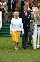 HM THE QUEEN ELIZABETH 11 and ARNAUD BAMBERGER at the Queen's Cup polo final sponsored by Cartier at Guards Polo Club, Smith's Lawn, Windsor Great Park on 18th June 2006.  The Final was between Dubai and the Broncos polo teams with Dubai winning.<br />