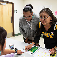 Victoria Brendon (right), talks with Esmerelda McCray about her daughter Caitlin Brendon (center) registering to vote during a meet and greet with Jonathan Nez and Myron Lizer, Sunday Sept. 30, 2018 at the Chichiltah chapter house. Voters in the Navajo Nation must register by Oct. 8 to be eligible to vote in November.