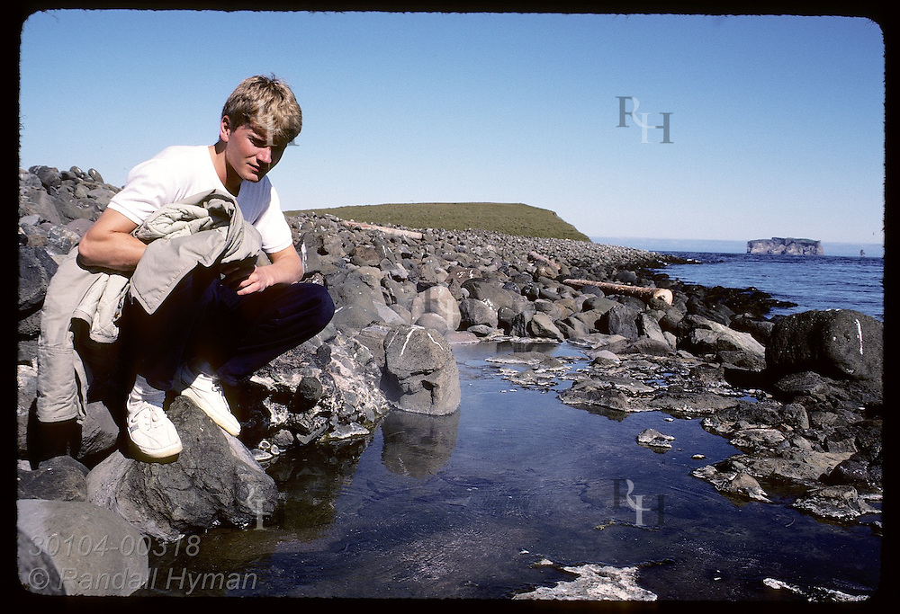 Poet Gyrdir Eliasson at hot spring where Grettir warmed up after swim from Drangey, horizon Iceland