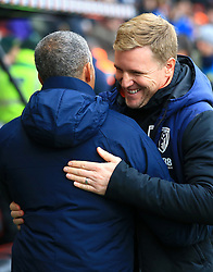 Brighton & Hove Albion manager Chris Hughton (left) and Bournemouth manager Eddie Howe embrace prior to kick-off during the Emirates FA Cup, third round match at the Vitality Stadium, Bournemouth.