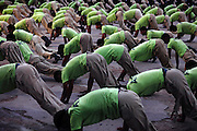 Recruits of the Shaheed Benazir Bhutto Elite Police Training Center, a commando and anti-terrorism academy on the outskirts of Karachi, are exercising at dawn. The training center was founded by retired colonel Abdul Wahid Khan, a brave officer who served as a gunship helicopter pilot in the Pakistani Air Force and around the globe with the United Nations, but who's first task as a young army officer in 1979 was to train Afghan Mujahedeen to fight the Soviet Army, the very Mujahedeen that are today's Taleban.