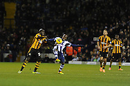Hull city's Yannick Sagbo (l) challenges WBA's Youssouf Mulumbu (c). Barclays Premier league, West Bromwich Albion v Hull city at the Hawthorns in West Bromwich, England on Saturday 21st Dec 2013. pic by Andrew Orchard, Andrew Orchard sports photography.