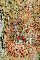 Ancient rock paintings of the Luoye people, ancestors of the modern day Zhuang minority in China.   These rudimentary images still baffle experts on their meaning and exactly how they were created some 70 metres above ground level.