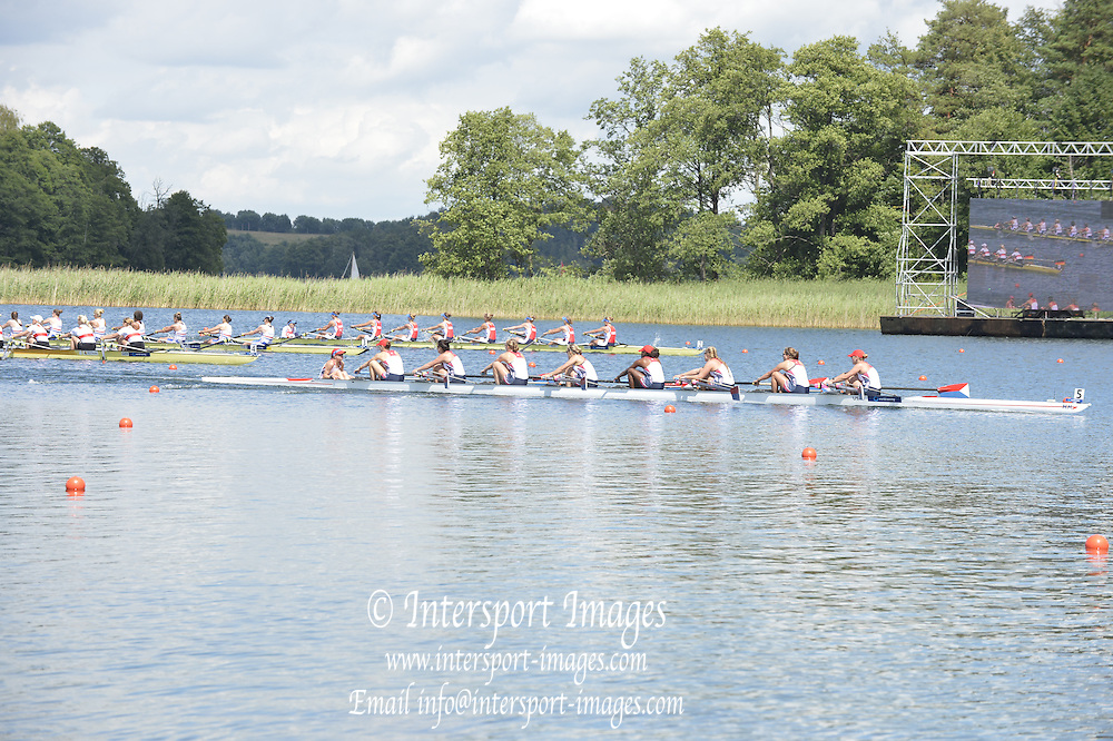 Trackai. LITHUANIA. ..USA BM8+ pass under the big screen, relaying their race,  as they go on to win women's eights, gold medal at the 2012 FISA U23 World Rowing Championships.  Lake Galve. ..14:15:30  Sunday  15/07/2012 [Mandatory Credit: Peter Spurrier/Intersport Images]..Rowing. 2012. U23.