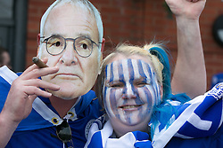 © Licensed to London News Pictures. 07/05/2016. Leicester, UK. Leicester City fans celebrating outside the King Power stadium before their match with Everton before lifting the Premiership trophy. Pictured, a cigar smoking manager and a fan. Photo credit: Dave Warren/LNP