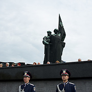Ukrainian military men attend a ceremony that marks 69 years since the Soviets defeated the Nazis, at the War Memorial in central Donetsk, amid tensions over the referendum for autonomy of the region to be held over the weekend.