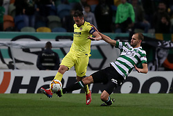 February 14, 2019 - Lisbon, Portugal - Villarreal's defender Mario Gaspar (L) vies with Sporting's forward Bas Dost from Holland during the UEFA Europa League Round of 32 First Leg football match Sporting CP vs Villarreal CF at Alvalade stadium in Lisbon, Portugal on February 14, 2019. (Credit Image: © Pedro Fiuza/NurPhoto via ZUMA Press)