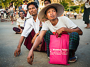 06 NOVEMBER 2015 - YANGON, MYANMAR:   Men listen to the speakers at the final NDF election rally of the 2015 election. The rally was held in central Yangon, next to the historic Sule Pagoda and across the street from Yangon city hall. The National Democratic Force (NDF) was formed by former members of the National League for Democracy (NLD) who chose to contest the 2010 general election in Myanmar because the NLD boycotted that election. There have been mass defections from the NFD this year because many of the people who joined the NFD in 2010 have gone back to the NLD, which is contesting this year's election and widely expected to win it. Campaigning in the Myanmar election ended Friday. People go to the polls Sunday.    PHOTO BY JACK KURTZ