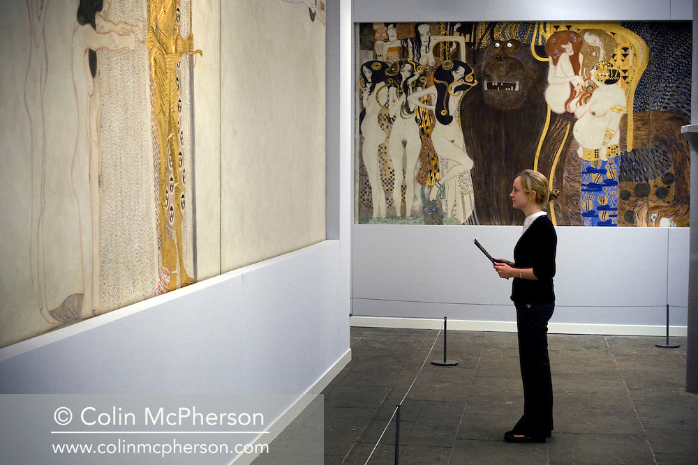 A visitor looking at a section of The Beethoven Frieze (1901-2), part of Gustav Klimt: Painting, Design and Modern Life in Vienna 1900 at the Tate Liverpool which opens on 30th May, 2008. The gallery is hosting the first-ever UK exhibition by Austrian artist Klimt (1862-1918) as part of Liverpool's reign as 2008 European Capital of Culture. The show includes a full-scale reconstruction of the The Beethoven Frieze in addition to numerous paintings, drawings and furniture designs and runs until 31st August, 2008.