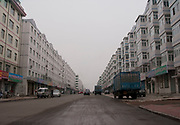 Apartment buildings in De Hui, Jilin Province. This town is part developed and part basic. Dusty and dirty