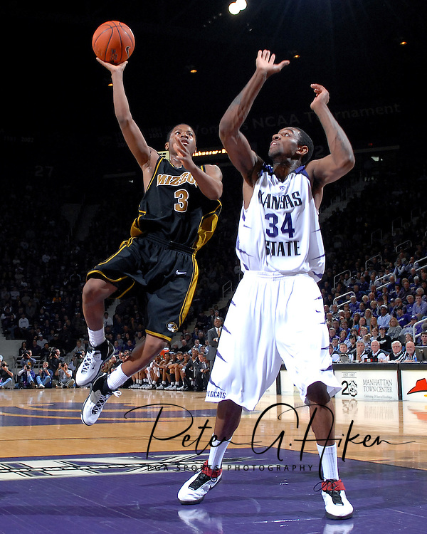 Missouri guard Stefhon Hannah (3) drives and scores past Kansas State guard Akeem Wright (34), during the first half at Bramlage Coliseum in Manhattan, Kansas, January 31, 2007.  The Wildcats lead the Tigers at halftime 36-33.