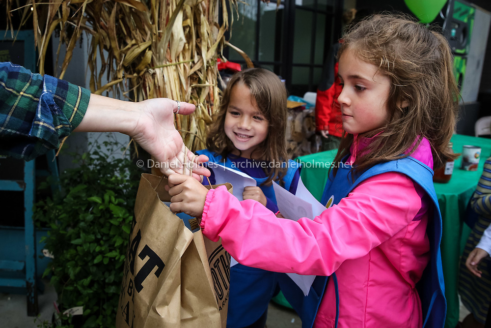 (10/22/16, MEDFIELD, MA) Megan Tello, 6, right, and Avery Konover, 6, of Daisy Troop 62377, collect food donations during the Medfield Girl Scouts service day outside Brothers Market in Medfield on Saturday. The girls were collecting donations for the Medfield Food Cupboard as part of the Medfield Girl Scouts service day. Daily News and Wicked Local Photo/Dan Holmes