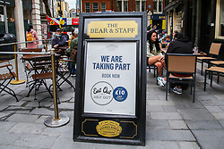 "© Licensed to London News Pictures. 31/08/2020. London, UK. ""WE ARE TAKING PART IN EAT OUT' poster outside a pub in central London as the government's Eat Out to Help Out scheme comes to an end today. Eat Out to Help Out was introduced by the Chancellor RISHI SUNAK to help boost  pubs and restaurants following the easing of COVID-19 lockdown. Under the scheme, restaurants offered customers half price food and soft drinks on Mondays, Tuesdays and Wednesdays during August and recouped the cash, up to a maximum of £10, from the government. Photo credit: Dinendra Haria/LNP"