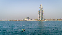 Aerial view of the luxurious Burj Al Arab Hotel and yellow boat, Dubai.