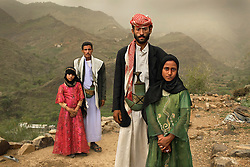 """""""Whenever I saw him, I hid. I hated to see him,"""" Tehani (in pink) recalls of the early days of her marriage to Majed, when she was 6 and he was 25. The young wife posed for a portrait with former classmate Ghada, also a child bride, outside their home in Hajjah, Yemen."""