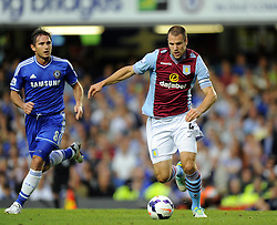 "Aston Villa's Ron Vlaar battles for the ball with Chelsea's Frank Lampard  - Photo mandatory by-line: Joe Meredith/JMP - Tel: Mobile: 07966 386802 21/08/2013 - SPORT - FOOTBALL - Stamford Bridge - London - Chelsea V Aston Villa - Barclays Premier League - EDITORIAL USE ONLY. No use with unauthorised audio, video, data, fixture lists, club/league logos or ""live"" services. Online in-match use limited to 45 images, no video emulation. No use in betting, games or single club/league/player publications"