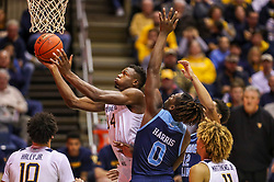 Dec 1, 2019; Morgantown, WV, USA; West Virginia Mountaineers forward Oscar Tshiebwe (34) shoots in the lane defended by Rhode Island Rams forward Jermaine Harris (0) during the second half at WVU Coliseum. Mandatory Credit: Ben Queen-USA TODAY Sports