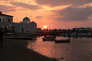 Sunset on the island of Mykonos, Greece.  Photograph by Dennis Brack