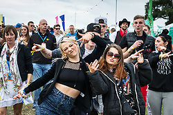 Excited young festivalgoers at the Brownstock Festival in Essex.