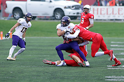 04 November 2017:   Bryce Holm & Decxavier Kelly-Martin tackle Clint Ratkovich during the Western Illinois Leathernecks at Illinois State Redbirds Football game at Hancock Stadium in Normal IL (Photo by Alan Look)
