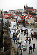 """SHOT 11/21/08 7:57:40 AM -  The Prague Castle (upper right) and Charles Bridge in Prague, Czech Republic. Prague Castle (Czech: Pra?ský hrad) is a castle in Prague where the Czech kings, Holy Roman Emperors and presidents of Czechoslovakia and the Czech Republic have had their offices. The Czech Crown Jewels are kept here. Prague Castle is one of the biggest castles in the world (according to Guinness Book of Records the biggest ancient castle) at about 570 meters in length and an average of about 130 meters wide. Charles Bridge is a famous historical bridge that crosses the Vltava river in Prague, Czech Republic. The bridge is 516 meters long and nearly 10 meters wide, resting on 16 arches shielded by ice guards. It is protected by three bridge towers, two of them on the Lesser Quarter side and the third one on the Old Town side. The Old Town bridge tower is often considered to be one of the most astonishing civil gothic-style buildings in the world. The bridge is decorated by a continuous alley of 30 statues and statuaries, most of them baroque-style, erected around 1700. Prague is the capital and largest city of the Czech Republic. Its official name is Hlavní m?sto Praha, meaning Prague, the Capital City. Situated on the River Vltava in central Bohemia, Prague has been the political, cultural, and economic centre of the Czech state for over 1100 years. The city proper is home to more than 1.2 million people, while its metropolitan area is estimated to have a population of over 1.9 million. Since 1992, the extensive historic centre of Prague has been included in the UNESCO list of World Heritage Sites. According to Guinness World Records, Prague Castle is the largest ancient castle in the world. Nicknames for Prague have included """"the mother of cities"""", """"city of a hundred spires"""" and """"the golden city"""". Since the fall of the Iron Curtain, Prague has become one of Europe's (and the world's) most popular tourist destinations. It is the sixth most-visited European cit"""
