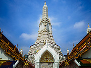 """11 SEPTEMBER 2017 - BANGKOK, THAILAND: The main Khmer style prang (chedi) at Wat Arun. Renovations are nearly finished at Wat Arun on the Thonburi side of the Chao Phraya River in Bangkok. Wat Arun is famous for its Khmer style main """"prang"""" (chedi). It was originally built in the Ayutthaya Period and rebuilt to its current form in the time of Rama II.       PHOTO BY JACK KURTZ"""