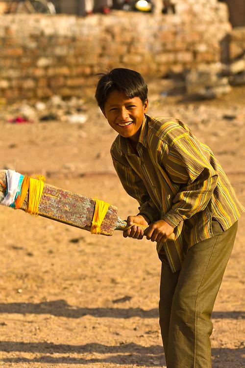 Boy playing cricket, Jodhpur, Rajasthan, India