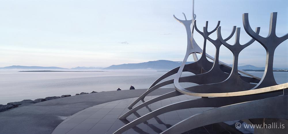 The sculpture Solfarid and the mountain Esja in the back, Reykjavik, Iceland - Sólfarið við Skúlagötu og Esjan í baksýn