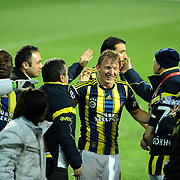 Fenerbahce's Dirk Kuijt (C) celebrate victory during their Turkish SuperLeague Derby match Trabzonspor between Fenerbahce at the Avni Aker Stadium at Trabzon Turkey on Sunday, 17 February 2013. Photo by TURKPIX