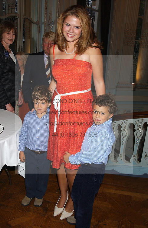 STELLA POWELL-JONES with her brothers SIMON & TOMMY SOROS children of Flora Fraser at a party to celebrate the publication of 'Princesses' the six daughters of George 111 by Flora Fraser held at the Saville Club, Brook Street, London W1 on 14th September 2004.<br />