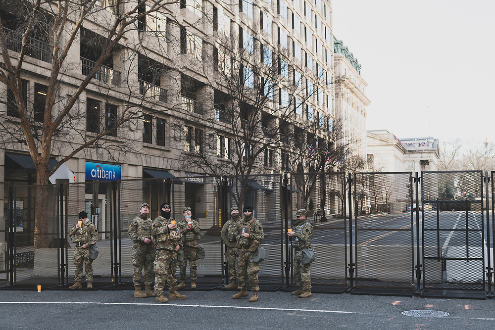 Washington DC, USA - January 19, 2021: Pennsylvania National Guard soldiers stand with their coffee at 14th and G Streets near the White House.