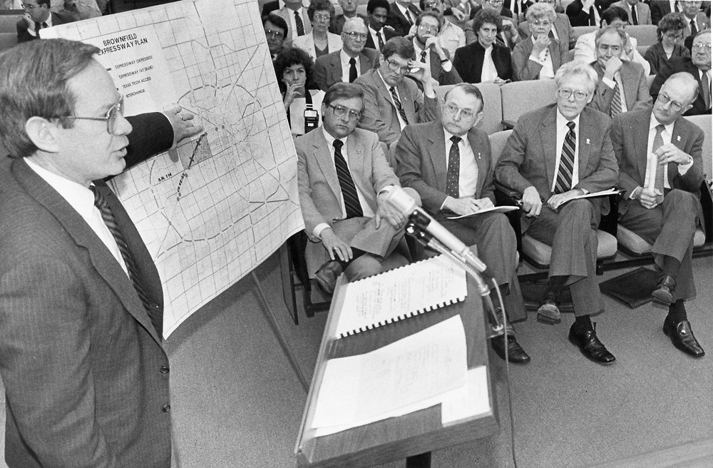 ©1991 City Council member giving road plan to Texas Highway Commission members.