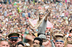© Licensed to London News Pictures. 26/06/2015. Pilton, UK.  Festival goers watch James Bay at Glastonbury Festival 2015 on the Pyramid Stage on Friday Day 3 of the festival.  This years headline acts include Kanye West, The Who and Florence and the Machine, the latter being upgraded in the bill to replace original headline act Foo Fighters.   Photo credit: Richard Isaac/LNP