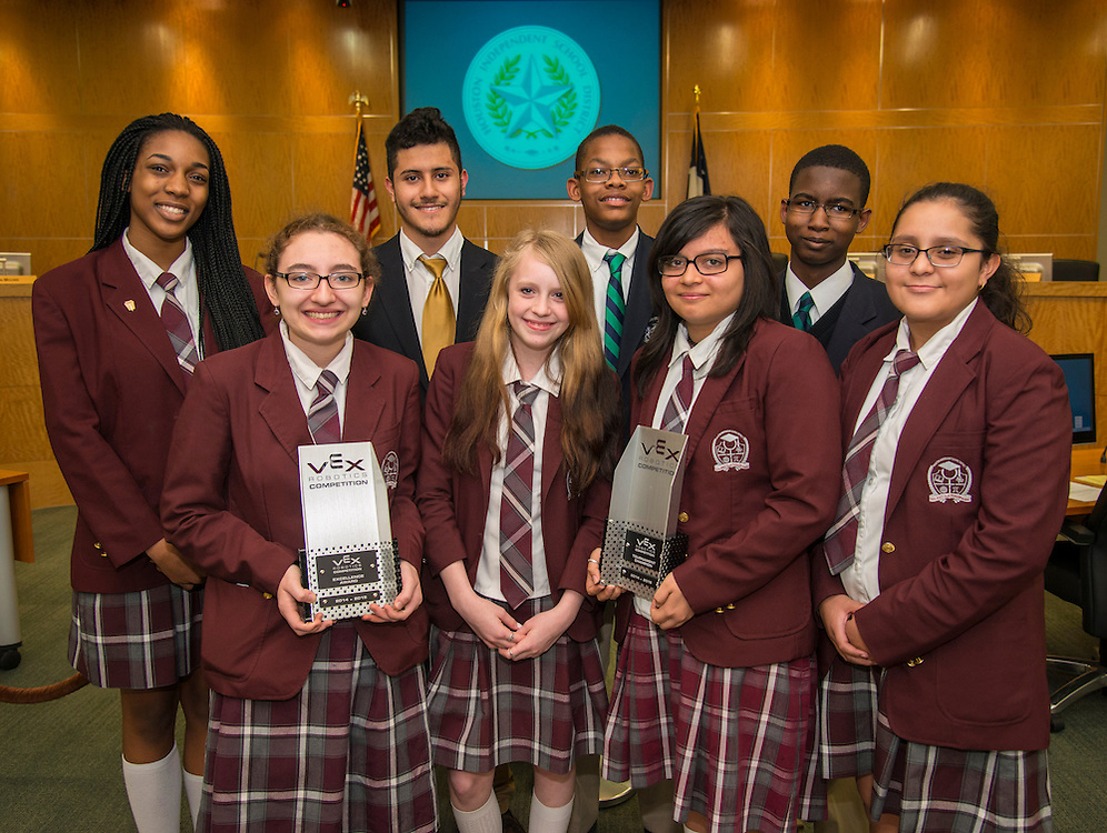 Members of the Young Women's College Preparatory Academy and Leland Young Men's College Preparatory Academy robotics teams pose for a photograph during the Houston ISD Board of Trustees meeting, April 9, 2015.