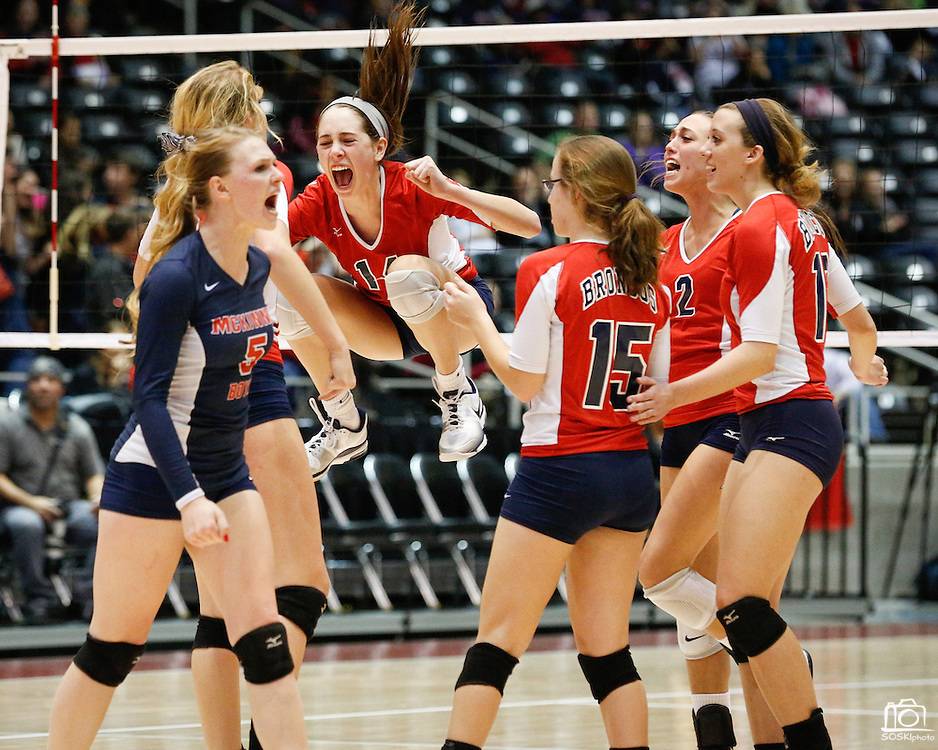 McKinney Boyd's Ashleigh Martin (14), center, and teammates celebrate a point against New Braunfels in the Class 5A semi-finals at the Curtis Culwell Center in Garland, Texas, on November 16, 2012.  (Stan Olszewski/The Dallas Morning News)