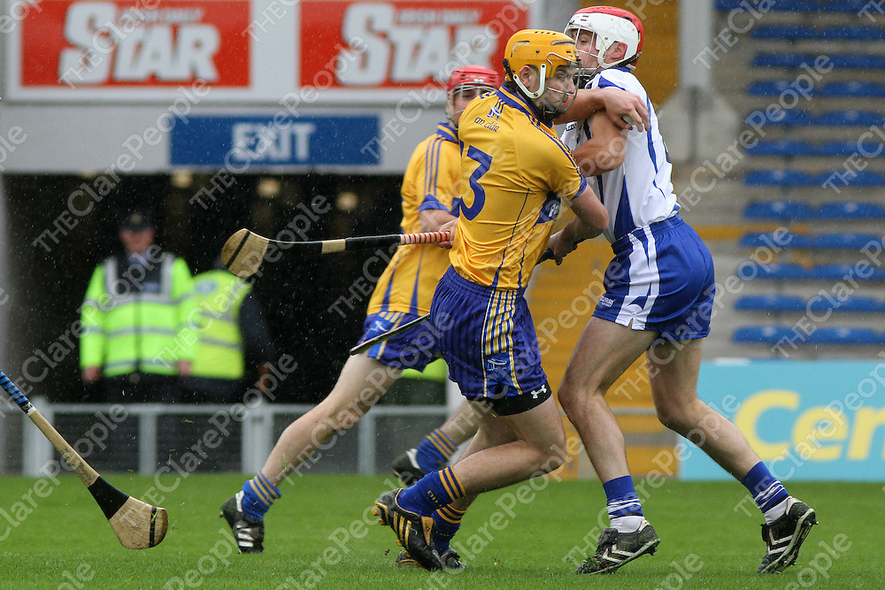 Clare's Martin Duggan's route to goal is impeded by Waterford's John Coffey in the Munster Intermediate Hurling Semi-Final. - Photograph by Flann Howard