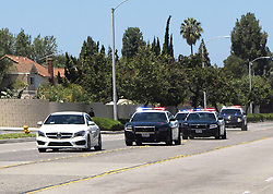 June 26, 2017 - Anaheim, CA, USA - Police pursue and later arrest a man driving a white Mercedes through Anaheim, CA on Monday, June 26, 2017. The vehicle theft suspect called 911 during the pursuit to inform police he would be driving to the police station. (Credit Image: © Ken Steinhardt/The Orange County Register via ZUMA Wire)