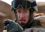 Sgt. Brian Allender, 30, of Ontario, points out the young man who he said hit in the mouth with a rock during an Alpha Company, 1st Platoon, visit to Al Sus, a village south of Kirkuk, on Saturday, Feb. 12, 2005. The youth was detained and brought to Forward Operation Base Warrior in Kirkuk for processing. Alpha Company is part of the 3rd Battalion, 116th Cavalry of the Oregon Army National Guard.  Photo by Randy L. Rasmussen/The Oregonian