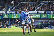Portsmouth Midfielder, Jamal Lowe (10) wins a header during the EFL Sky Bet League 1 match between Portsmouth and Rochdale at Fratton Park, Portsmouth, England on 13 April 2019.