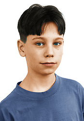 Portrait of young boy looking serious,