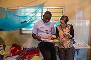 Dr Siobhan Neville and Dr Godfrey Kambanga discuss patient notes on the NICU (Neonatal Intensive Care Unit) Ward. St Walburg's Hospital, Nyangao. Lindi Region, Tanzania.