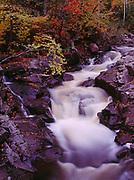 Autumn colors along the Caribou River at dusk, Caribou Falls Wayside, Minnesota.