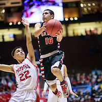 031015  Adron Gardner/Independent<br /> <br /> Grants Pirate Matt Vail (10) flies past Roswell Coyote Frank De La O (22) during a 4A New Mexico state basketball tournament quarterfinal at The Pit in Albuquerque Wednesday.