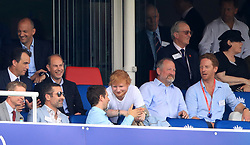 Ed Sheeran (centre) and Damien Lewis (right) in the stands during the ICC Cricket World Cup group stage match at Lord's, London.