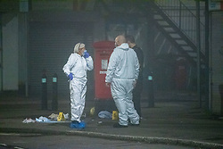 © Licensed to London News Pictures. 11/11/2020. Slough, UK. Forensic investigators stand next to medical waste marked out with evidence identification markers on Stoke Poges Lane. A person was reportedly stabbed in Slough on Tuesday 10/11/2020. A large cordon was put in place by Thames Valley Police centred around shops on Stoke Poges Lane and included a large section of Bradley Road. Photo credit: Peter Manning/LNP
