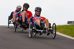 Queen Elizabeth Olympic Park, London. September 13th 2014. In the Recumbent IRecB1category, Robert Cromey-Hawke (R), John-James Chalmers (c) and Paul Vice (L) use teamwork to build a commanding lead as wounded servicemen and women from 13 different countries compete for sporting glory during the cycling competition at the Invictus Games.