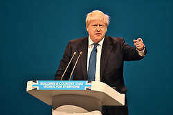 © Licensed to London News Pictures. 03/10/2017. Manchester, UK. British foreign secretary BORIS JOHNSON delivers  his keynote speech on day three of the Conservative Party Conference. The four day event is expected to focus heavily on Brexit, with the British prime minister hoping to dampen rumours of a leadership challenge. Photo credit: Ben Cawthra/LNP