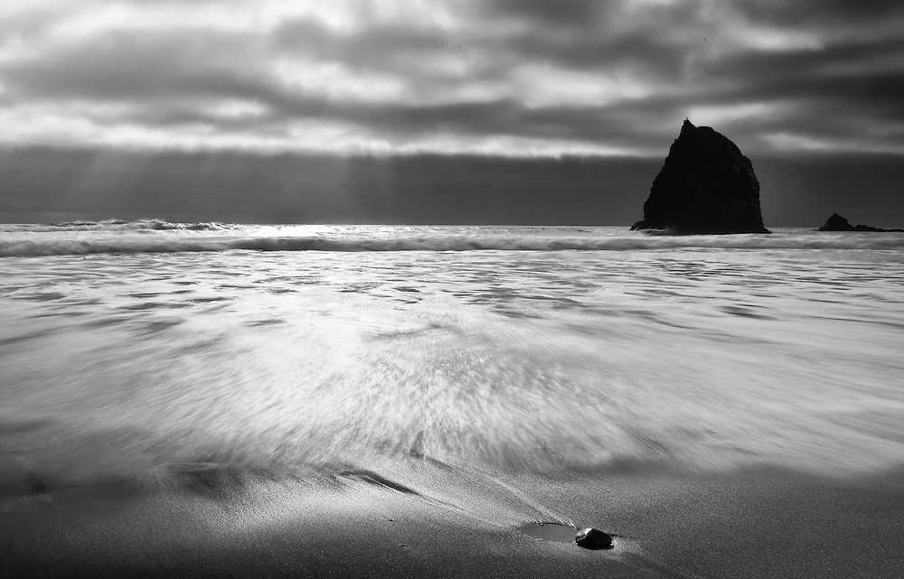 A desolate beach in black and white as a storm approaches near Fort Bragg California just off Pacific Coast Highway 1