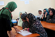 Afghanistan. Herat Women's prison - prisoners in a classroom learning to read